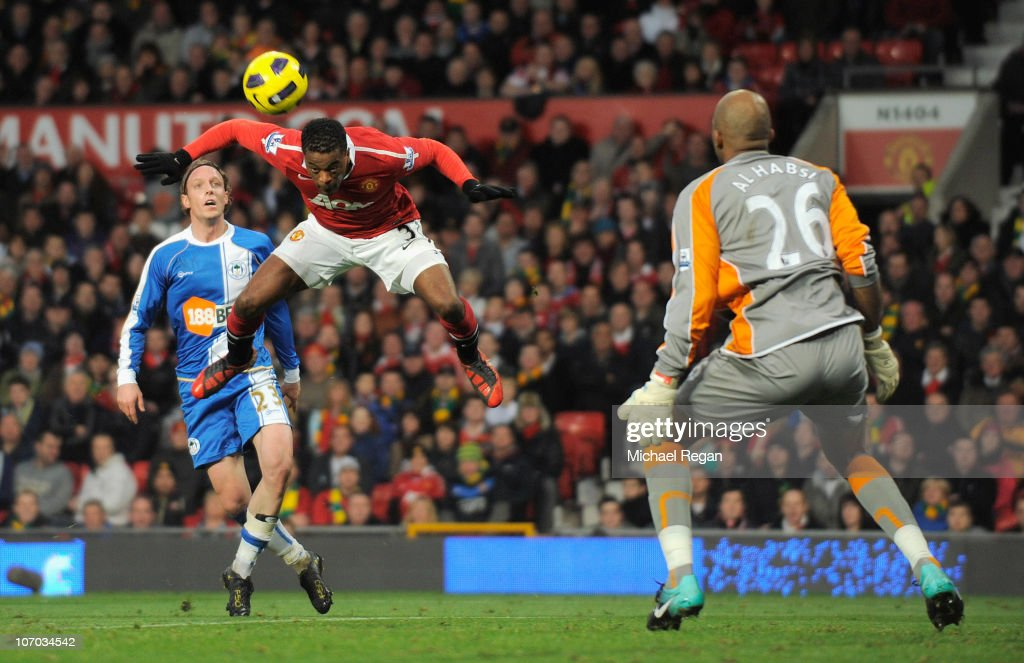 Patrice Evra of Manchester United heads the ball past Wigan's goalkeeper Ali Al Habsi to score the opening goal during the Barclays Premier League match between Manchester United and Wigan Athletic at Old Trafford on November 20, 2010 in Manchester, England.