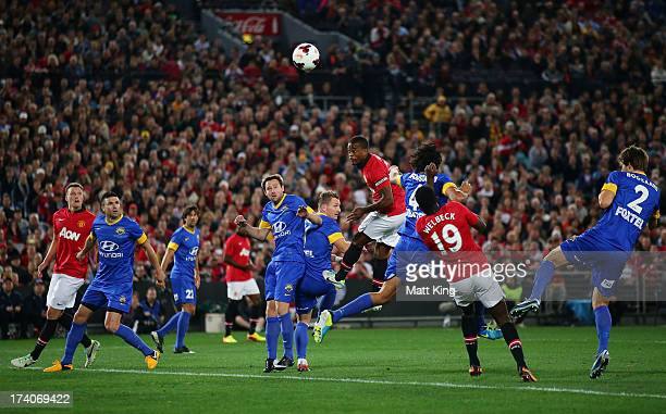 Patrice Evra of Manchester United heads the ball towards goal during the match between the ALeague AllStars and Manchester United at ANZ Stadium on...
