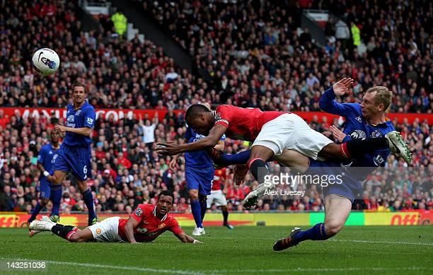 Patrice Evra of Manchester United hits the post with a diving header during the Barclays Premier League match between Manchester United and Everton...