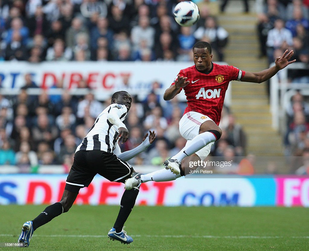 Patrice Evra of Manchester United in action against Shola Ameobi of Newcastle United during the Barclays Premier League match between Newcastle United and Manchester United at Sports Direct Arena on October 7, 2012 in Newcastle upon Tyne, England.