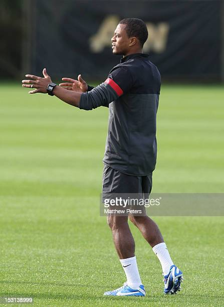 Patrice Evra of Manchester United in action during a first team training session ahead of their UEFA Champions League match against Cluj at...