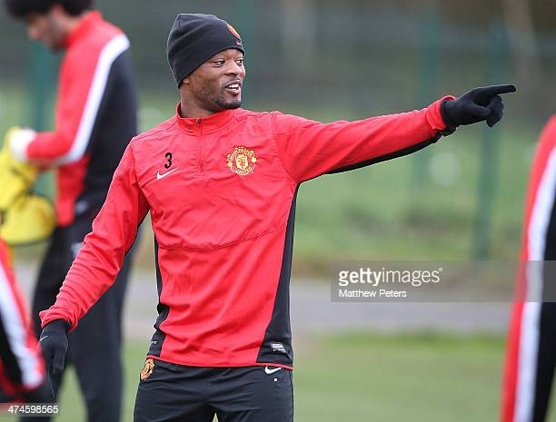 Patrice Evra of Manchester United in action during a first team training session ahead of their UEFA Champions League Round of 16 match against...
