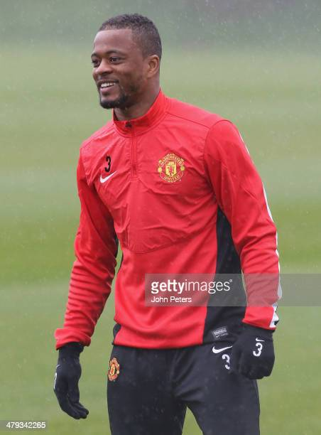 Patrice Evra of Manchester United in action during a first team training session ahead of their UEFA Champions League Round of 16 second leg match...