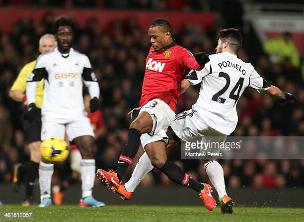 Patrice Evra of Manchester United in action with Alejandro Pozuelo of Swansea City during the Barclays Premier League match between Manchester United...