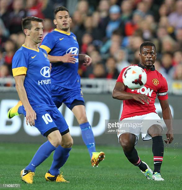 Patrice Evra of Manchester United in action with Liam Miller of ALeague AllStars during the match between the ALeague AllStars and Manchester United...
