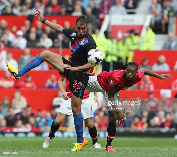 Patrice Evra of Manchester United in action with Marouane Chamakh of Crystal Palace during the Barclays Premier League match between Manchester...