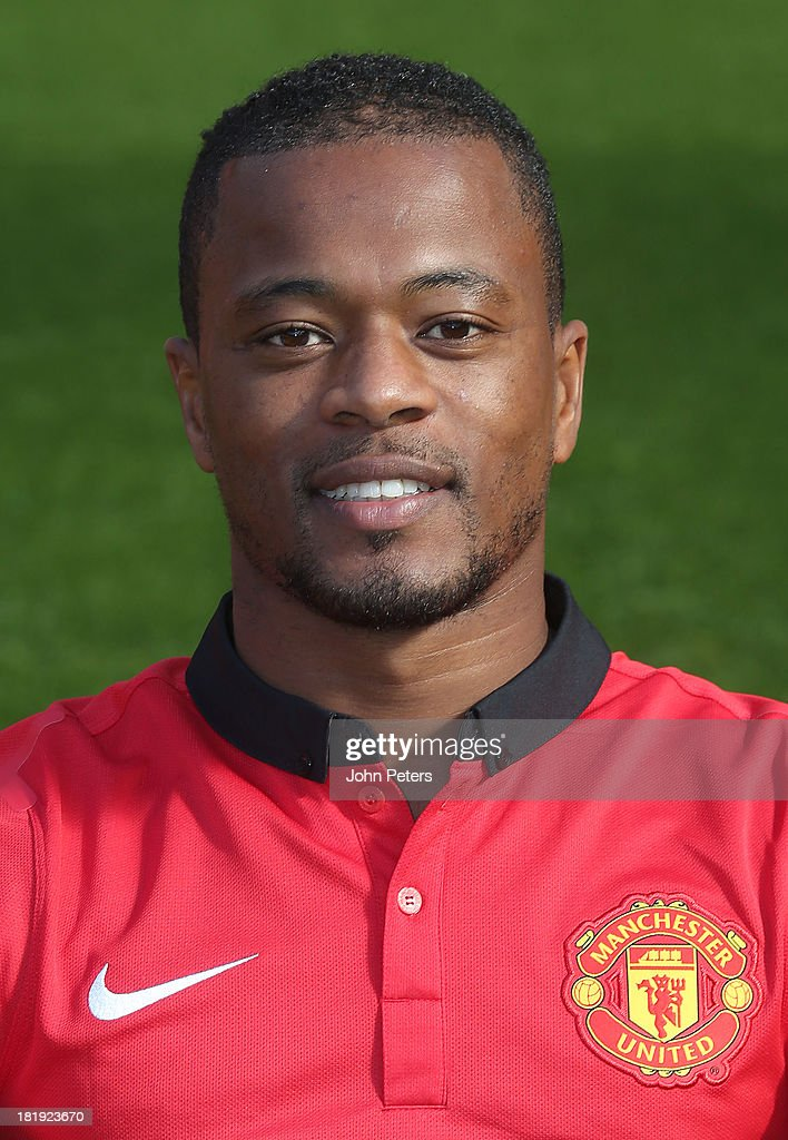 Patrice Evra of Manchester United poses at the annual club photocall at Old Trafford on September 26, 2013 in Manchester, England.