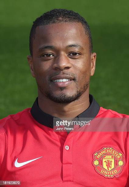 Patrice Evra of Manchester United poses at the annual club photocall at Old Trafford on September 26 2013 in Manchester England