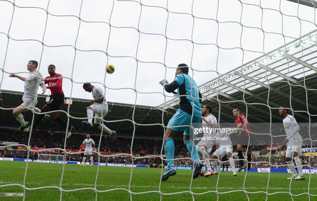 Patrice Evra of Manchester United scores his goal during the Barclays Premier League match between Swansea City and Manchester United at the Liberty Stadium on December 23, 2012 in Swansea, Wales.