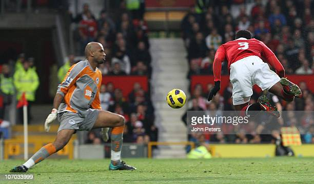 Patrice Evra of Manchester United scores their first goal during the Barclays Premier League match between Manchester United and Wigan Athletic at...