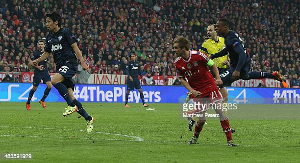 Patrice Evra of Manchester United scores their first goal during the UEFA Champions League quarterfinal second leg match between Bayern Munich and...