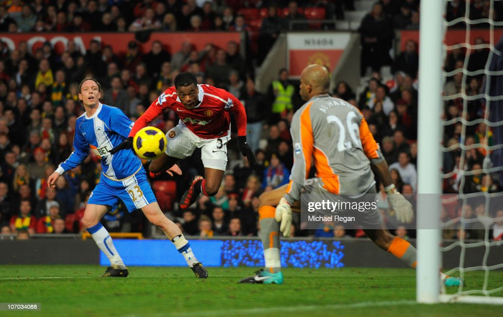 Patrice Evra of Manchester United scores to make it 1-0 during the Barclays Premier League match between Manchester United and Wigan Athletic at Old Trafford on November 20, 2010 in Manchester, England.
