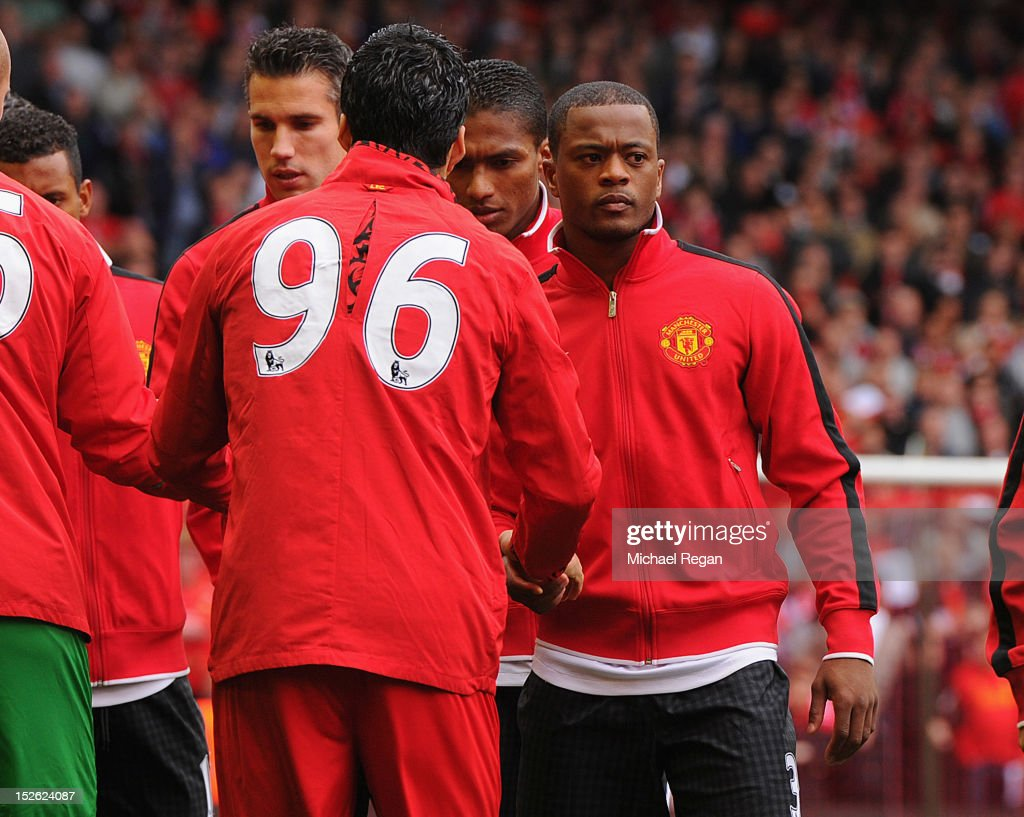 Patrice Evra of Manchester United shakes hands with Luis Suarez of Liverpool before the Barclays Premier League match between Liverpool and Manchester United at Anfield on September 23, 2012 in Liverpool, England.