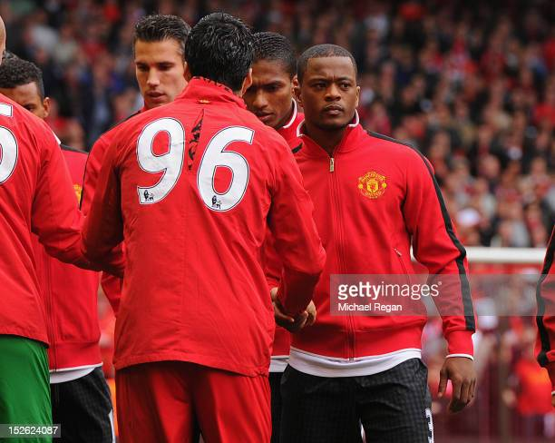 Patrice Evra of Manchester United shakes hands with Luis Suarez of Liverpool before the Barclays Premier League match between Liverpool and...