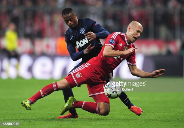 Patrice Evra of Manchester United tackles Arjen Robben of Bayern Muenchen during the UEFA Champions League Quarter Final second leg match between FC...