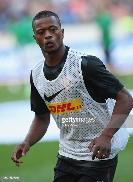 Patrice Evra of Manchester United warms up ahead of the pre-season friendly match between Hannover 96 and Manchester United at AWD Arena on August...
