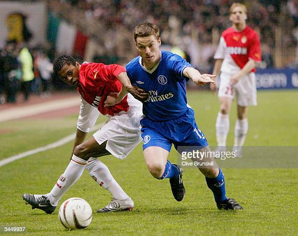 Patrice Evra of Monaco tries to tackle Scott Parker of Chelsea during the UEFA Champions League Semi Final first leg match between AS Monaco and...