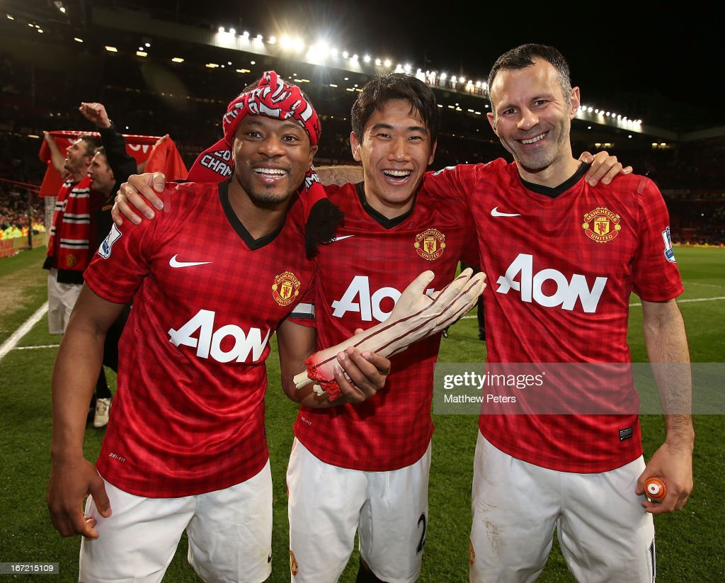 Patrice Evra, Shinji Kagawa and Ryan Giggs of Manchester United celebrate after the Barclays Premier League match between Manchester United and Aston Villa at Old Trafford on April 22, 2013 in Manchester, England.