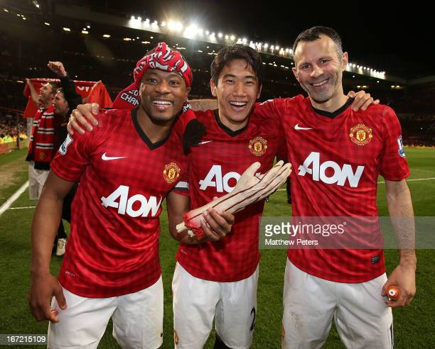 Patrice Evra Shinji Kagawa and Ryan Giggs of Manchester United celebrate after the Barclays Premier League match between Manchester United and Aston...