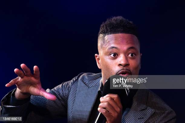 Patrice Evra speaking with Gabby Logan on stage at the 'Prime Video Presents Sport' event at Pan Pacific on October 12, 2021 in London, England. At...