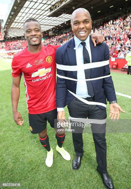 Patrice Evra wraps foremr teammate Quinton Fortune in tape after the Michael Carrick Testimonial match between Manchester United '08 XI and Michael...
