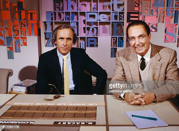 Patrice Laffont presenter and Jo Frachon assistant and member of group 'Les compagnons de la chanson' on the set of TV quiz show Des chiffres et des...