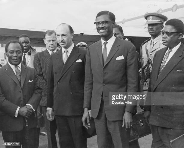 Patrice Lumumba Prime Minister of the Republic of the Congo is met by British statesman John Profumo upon his arrival at London Airport en route to...
