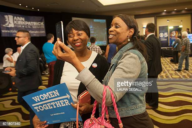 Patrice Register of Avondale, Arizona, and Pat Gillum of Peoria, Arizona, supporters of Democratic presidential candidate Hillary Clinton, record a...