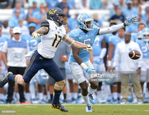 Patrice Rene of the North Carolina Tar Heels defends a pass to Vic Wharton III of the California Golden Bears during their game at Kenan Stadium on...