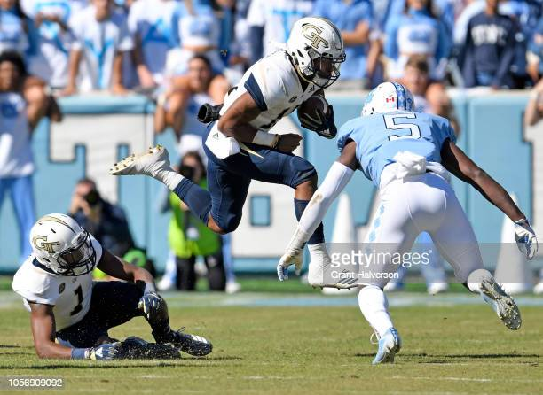 Patrice Rene of the North Carolina Tar Heels looks to tackle Tobias Oliver of the Georgia Tech Yellow Jackets in the first half of their game at...