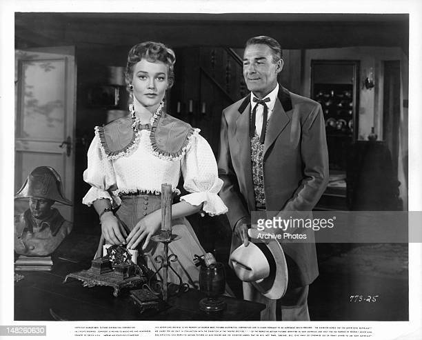 Patrice Wymore and Randolph Scott standing at desk in a scene from the film 'The Man Behind The Gun' 1953
