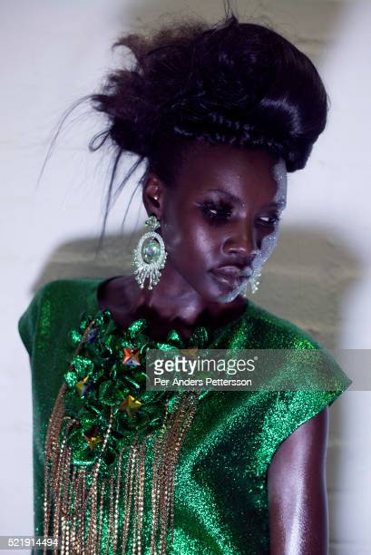 Patricia Akello a model walking for the designer David Tlale waits backstage before a show on August 1 2015 at Gallery MOMO in Cape Town South Africa...