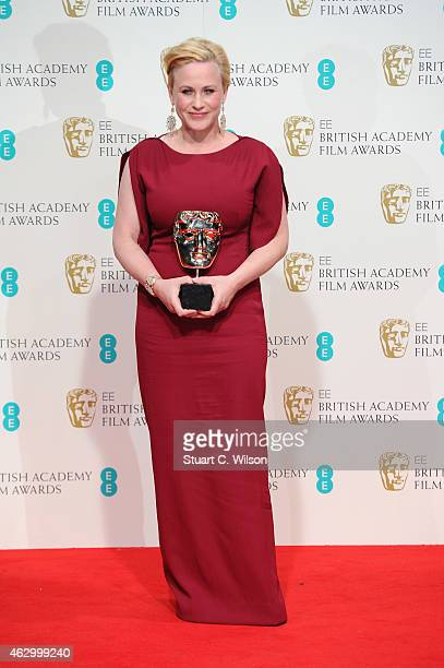 Patricia Arquette poses in the winners room with the award for Best Supporting Actress for 'Boyhood' at the EE British Academy Film Awards at The...