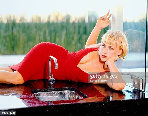Patricia Arquette Reclining on Counter Behind Sink