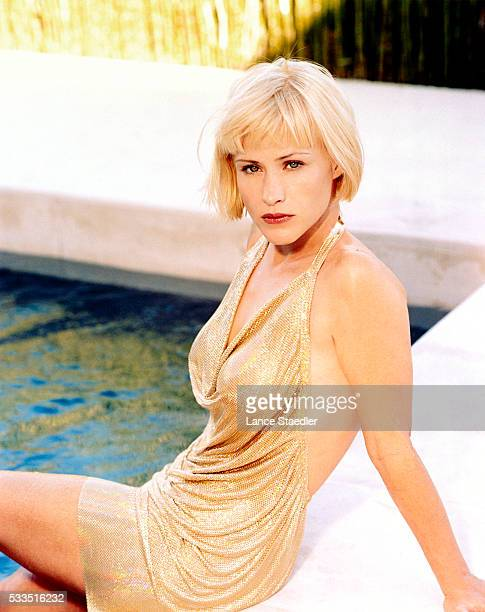 Patricia Arquette Seated by pool
