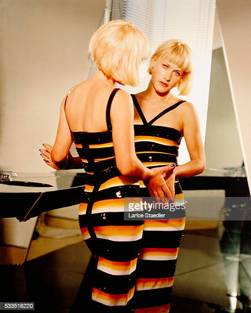 Patricia Arquette Standing in Front of Mirror