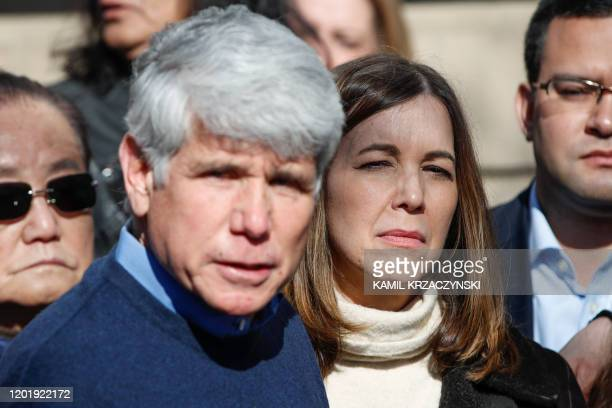 Patricia Blagojevich listens to her husband former Illinois governor Rod Blagojevich as he speaks outside of their house on February 19 2020 in...