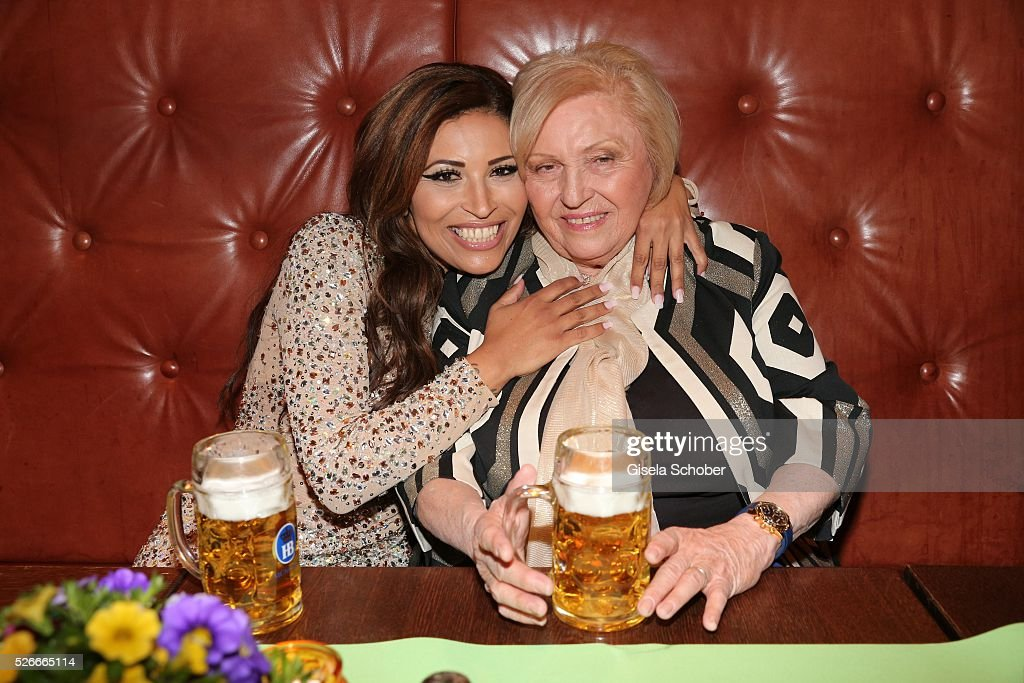 Patricia Blanco and her mother Mireille Blanco, former wife of Roberto Blanco with beer during the 11th anniversary 'Highway to Helles' of 'Bachmaier Hofbraeu' in Munich on April 30, 2016 in Munich, Germany.