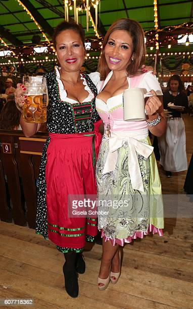 Patricia Blanco and her sister Mercedes Blanco pose during the Oktoberfest at AugustinerBraeu /Theresienwiese on September 19 2016 in Munich Germany