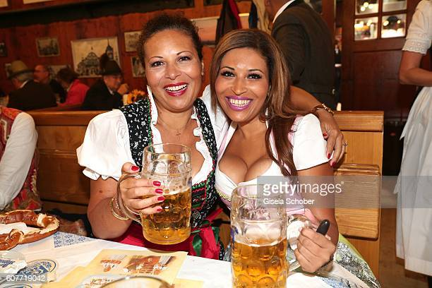 Patricia Blanco and her sister Mercedes Blanco pose during the Oktoberfest at Augustiner-Braeu /Theresienwiese on September 19, 2016 in Munich,...