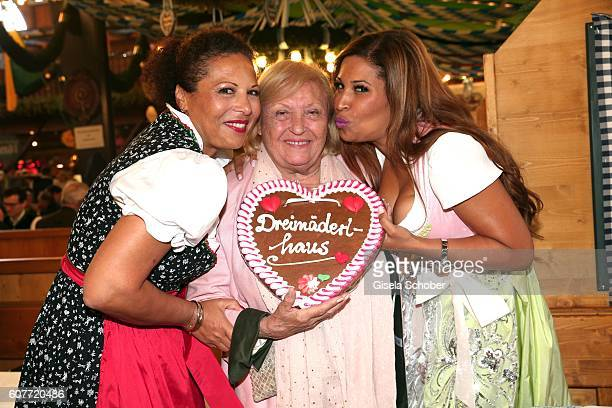 Patricia Blanco, her mother Mireille Blanco and her sister Mercedes Blanco pose during the Oktoberfest at Augustiner-Braeu at Theresienwiese on...