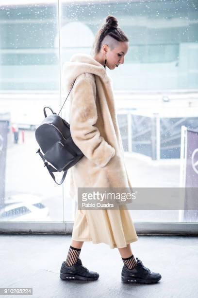 Patricia Blas wears Nike trainers Paisie trousers Stradivarious Bag and Nan Judy Coat at Ifema during Mercedes Benz Fashion Week Madrid Autumn /...
