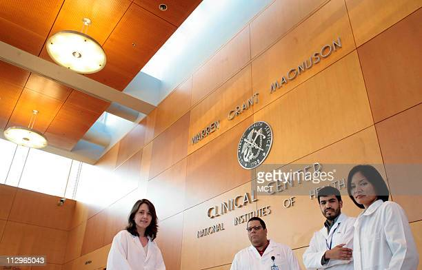 Patricia Burgos Carlos Gonzalez Jorge Contreras and Frances Calderon stand in the lobby of the National Institutes of Health Clinical Center in...