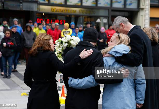 Patricia Campbell mother of Krystle Campbell looks up after laying a wreath at the site of one of the bombings in honor of her late daughter and the...