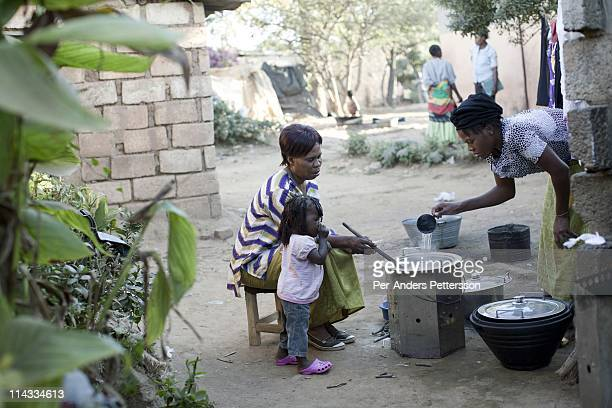Patricia Cheelo age 52 uses a cook stove supplied by Clean Development Mechanism on June 16 in Lusaka Zambia Patricia works at a school in Lusaka She...