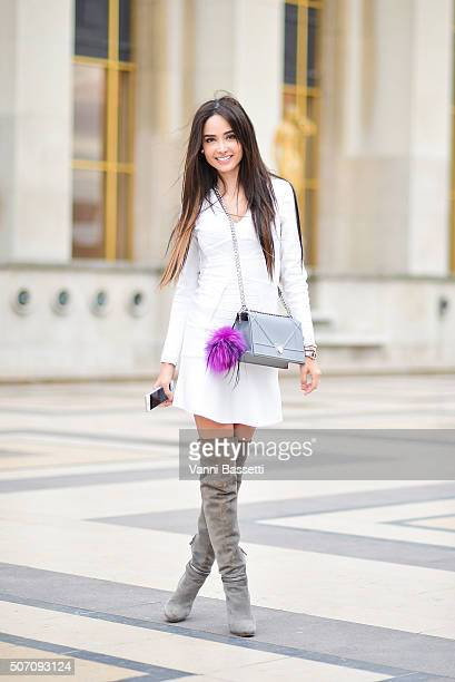 Patricia Contreras poses wearing an Herve Leger dress Fendi boots and Dior bag before the Elie Saab show at the Theatre National de Chaillot during...
