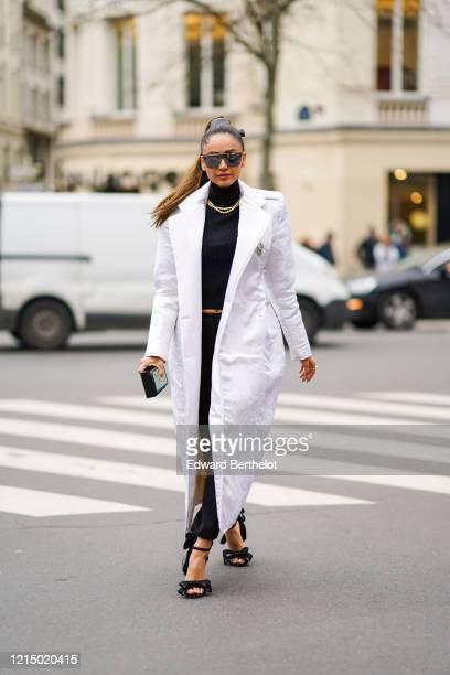 Patricia Contreras wears sunglasses a white long coat a necklace a black turtleneck dress shoes outside Ralph Russo during Paris Fashion Week...