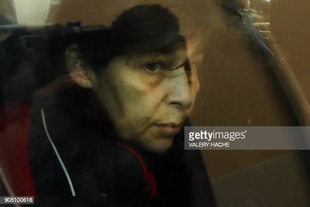 Patricia Dagorn a woman suspected of being a serial poisoner trapping wealthy widowers from the Cote d'Azur is seen in a car as she arrives at the...