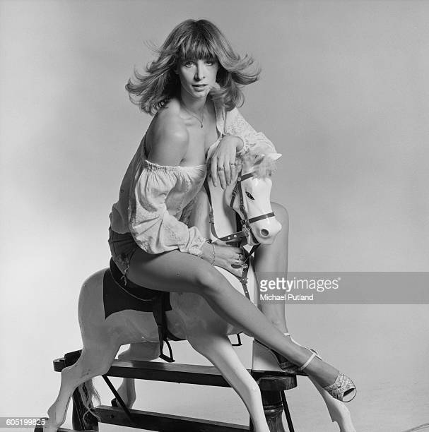 Patricia 'Dee Dee' Wilde of British TV dance troupe Pan's People sitting on a rocking horse January 1976 Pan's People are a regular feature of the...