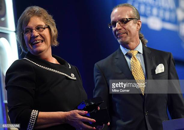 Patricia DePottey granddaughter of Raymond Parks accepts Raymond's Hall of Fame Ring from Kyle Petty at the NASCAR Hall of Fame on January 20 2017 in...